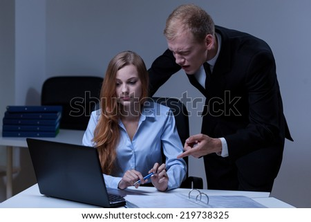 Angry boss and his confused employee in the office