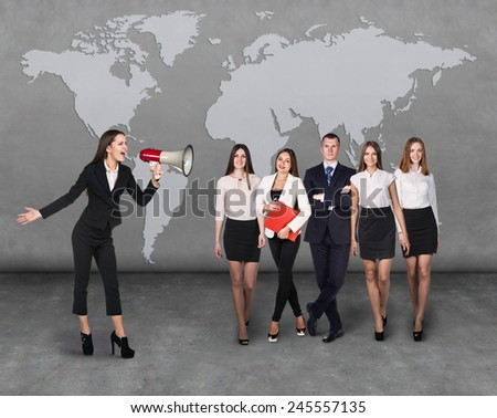 Angry boss. Business woman with megaphone standing in front of other busines people - stock photo