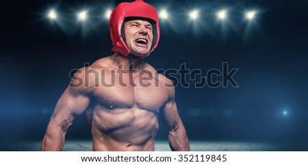Angry boxer with headgear against desert landscape - stock photo