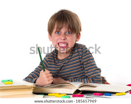 angry boy hates learning - stock photo
