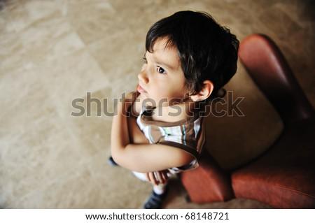 Angry boy indoor - stock photo