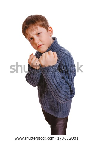 angry boy teenager fight  clenched his fists isolated on white background - stock photo
