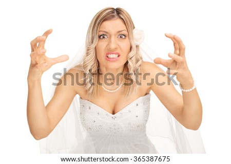 Angry bride threatening to strangle someone and looking at the camera isolated on white background - stock photo