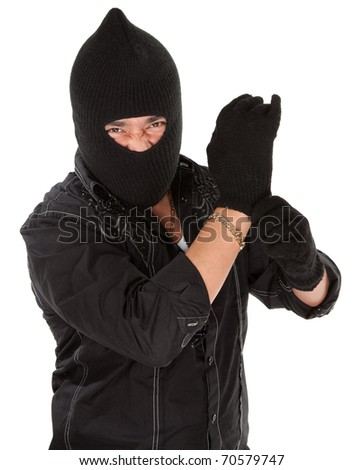 Angry burglar wearing a black woollen mask - stock photo
