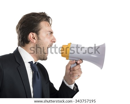 Angry business boss shouting with his megaphone - stock photo