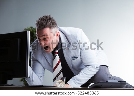 angry business man discovering something upsetting he didn't consider and reacting in the most useless way