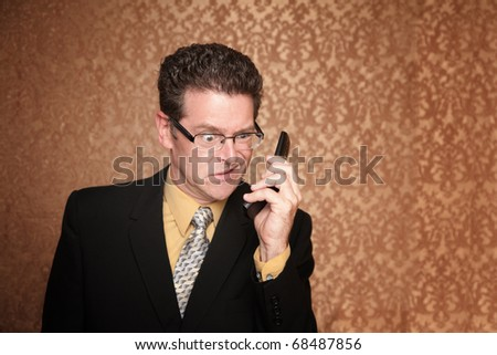Angry Business Man Hears Something Annoying on His Phone - stock photo