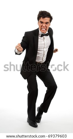 Angry business man in rage holding his fists, isolated on white - stock photo