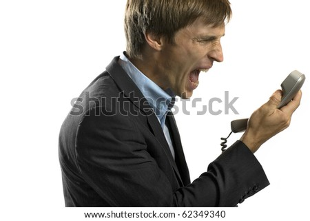 Angry business man on the phone - stock photo