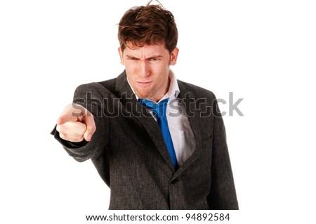 angry business man pointing someone out - stock photo