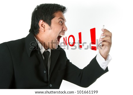 Angry business man screaming on cell mobile phone