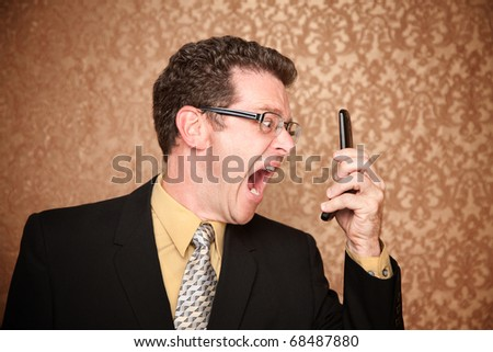 Angry Business Man Shouting at His Phone - stock photo
