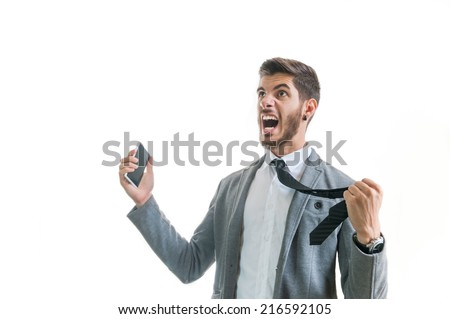 Angry business man with phone screaming isolated on white with copy space for text. Office worker with anger management problems getting angry for losing money. Stressful office situation concept - stock photo