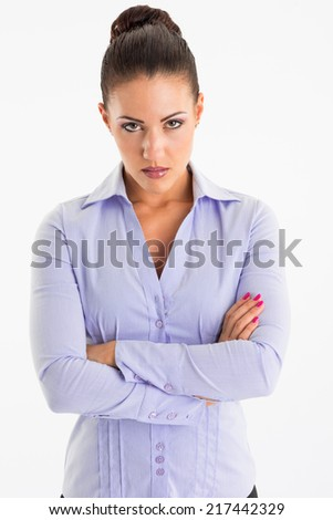 Angry business woman posing on white background - stock photo