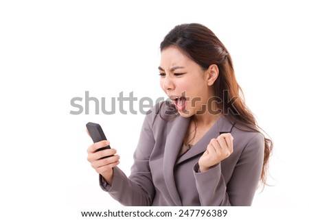 angry business woman screaming, shouting at her smartphone - stock photo