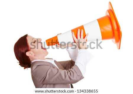 Angry business woman shouting in a big traffic cone - stock photo