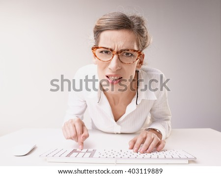 Angry business woman solving problem - stock photo
