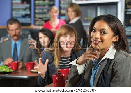 Angry business woman threatening coworker in cafeteria - stock photo