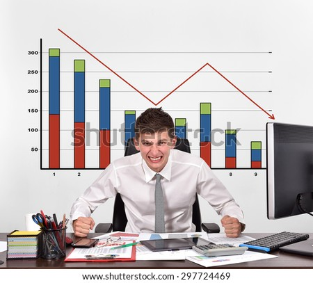 angry businessman and drawing falling chart on wall - stock photo