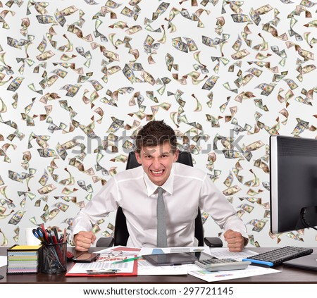 angry businessman and falling dollar bills - stock photo