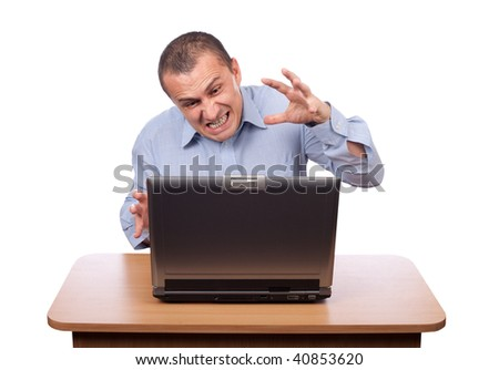 Angry businessman at laptop isolated on white - stock photo