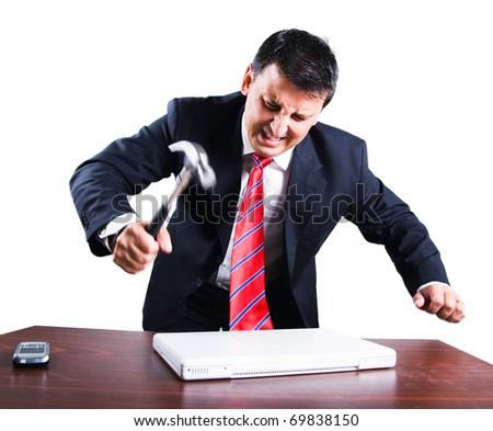 Angry businessman breaking his laptop - stock photo