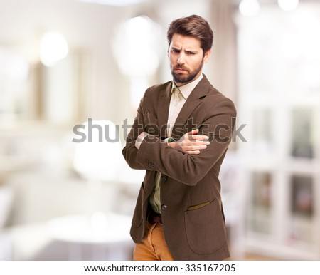 angry businessman cross arms pose