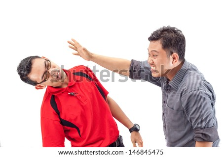 angry businessman is slapping across the businessman's face - stock photo