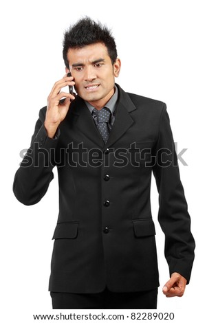 angry businessman on the phone isolated on white background - stock photo
