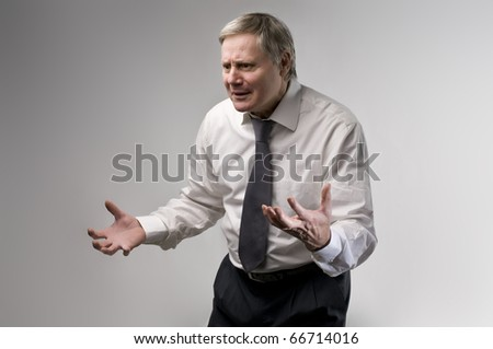 Angry businessman quarreling - stock photo