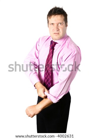 Angry businessman rolling up his sleeve, ready to have a fist fight, isolated on white. - stock photo