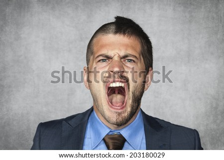 angry businessman screaming, funny haircut - stock photo