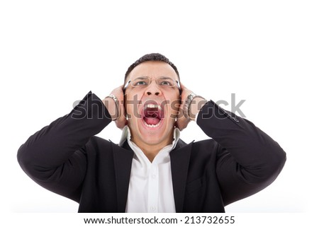 angry businessman screaming holding his head - stock photo