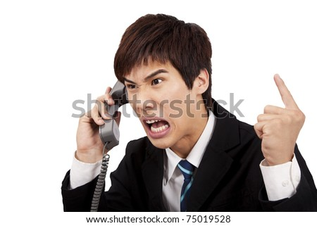angry businessman screaming on the phone and isolated on white background - stock photo