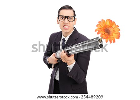 Angry businessman shooting flowers from a rifle isolated on white background - stock photo