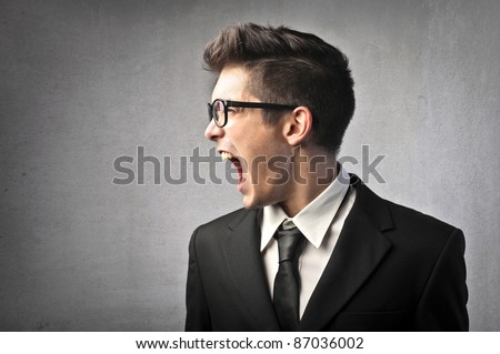 Angry businessman shouting - stock photo