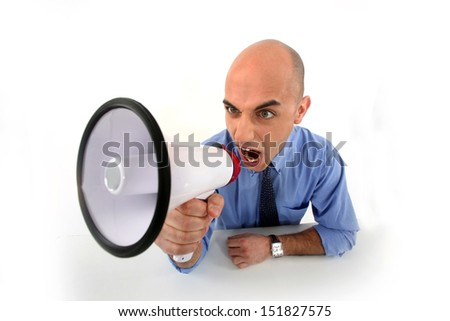angry businessman shouting in loudspeaker - stock photo