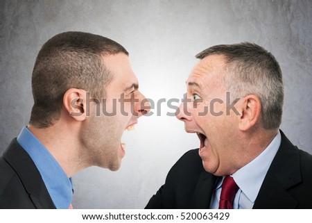 Angry businessman shouting to a colleague