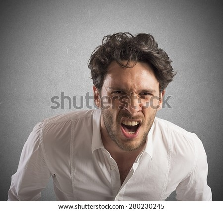 Angry businessman stressed out from work screams - stock photo