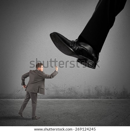 Angry businessman struggle against his authoritarian boss - stock photo
