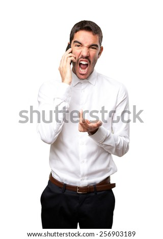 Angry businessman talking on the phone - stock photo