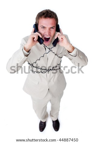 Angry businessman tangle up in phone wires isolated on a white background
