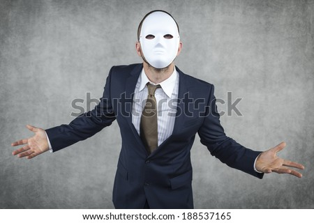 angry businessman wearing a mask - stock photo