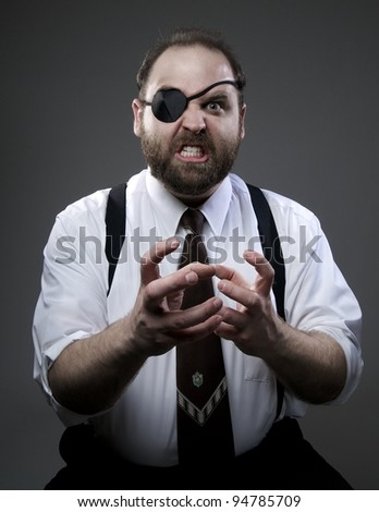 Angry businessman wearing an eye patch - stock photo