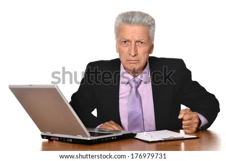 Angry businessman with a laptop on a light background