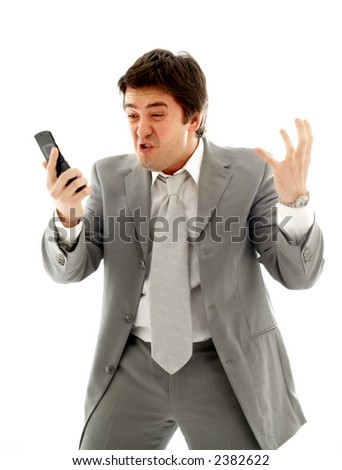 angry businessman with cellular phone over white - stock photo