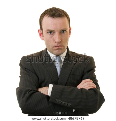 Angry businessman with crossed arms - stock photo