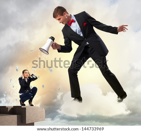 Angry businessman with megaphone shouting at colleague