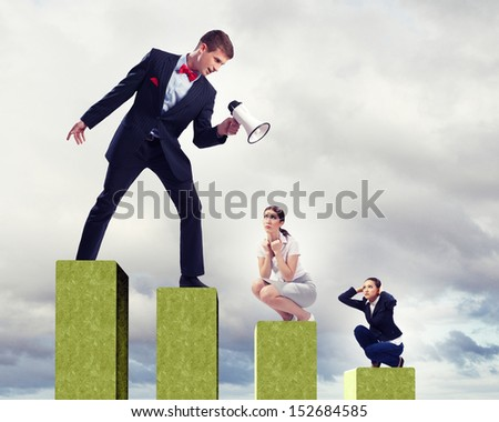 Angry businessman with megaphone shouting at colleague - stock photo
