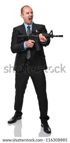 angry businessman with rifle isolated on white background